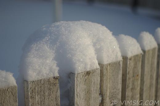 snö på staket